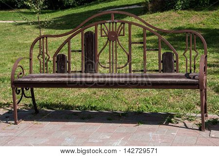 wooden bench in a park close up.