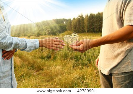 two hands couple of love with heart on nature