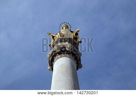 ZAGREB, CROATIA - NOVEMBER 07: Golden statue of Virgin Mary, Zagreb cathedral, Croatia on November 07, 2015