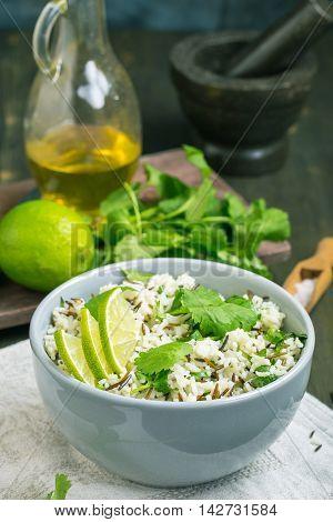 Bowl of cilantro lime basmati rice on kitchen table