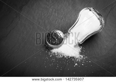 Salt shaker on slate board