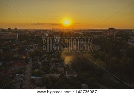 Sunset over the city. The sleeping area park view from above.