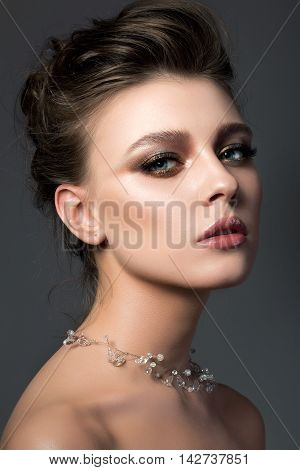 Portrait Of Young Beautiful Woman With Bridal Makeup And Coiffure