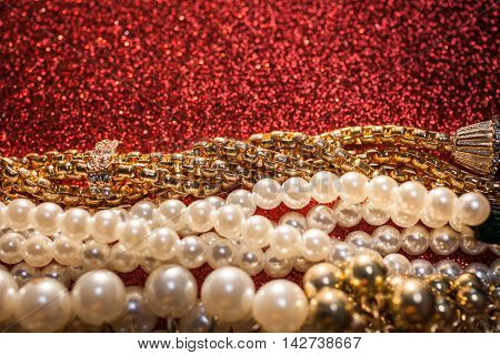 Luxury beautiful pearl necklace on a glitter background.