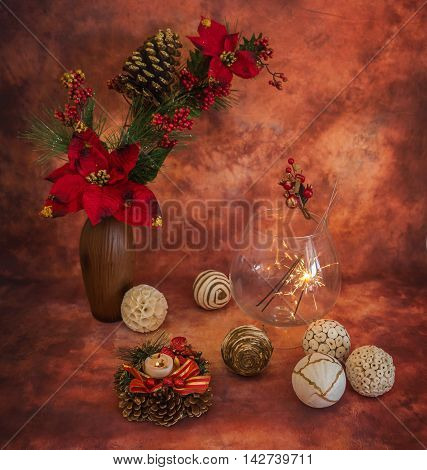 Christmas still life with sparklers and ornaments in warm colors