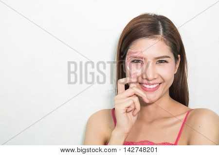 Portrait Of Cheerful Beautiful Woman Making Curl Eyelashes Using Curling Cosmetic Tool.