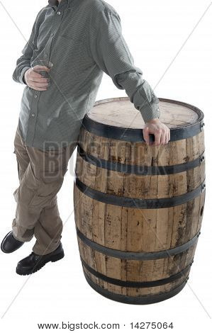 Man Leans On Whiskey Barrel