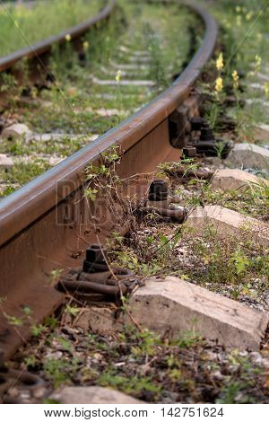 rails and sleepers of railway track in summer