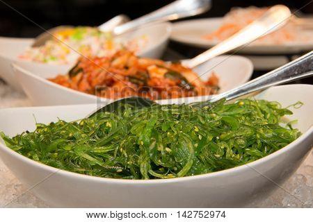 A Japanese salad seaweed with sesame seeds