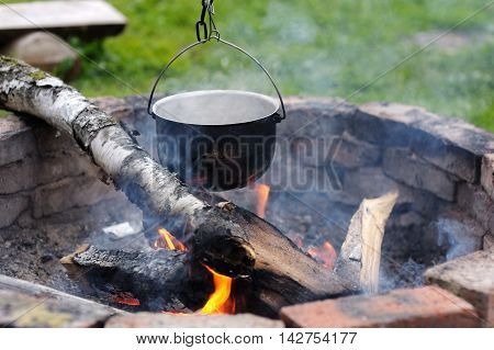 Close Up Of Soup Cooking Over Campfire. Travel.
