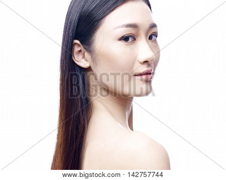 studio portrait of a young and beautiful asian model isolated on white background.