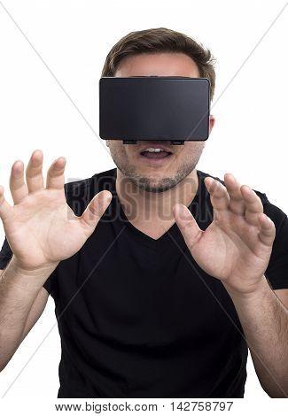 Gamer touching something while wearing interactive virtual reality headset