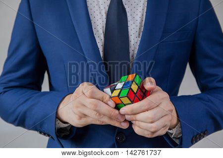 Businessman solving cubic problems - problem solution and making strategic moves concept.