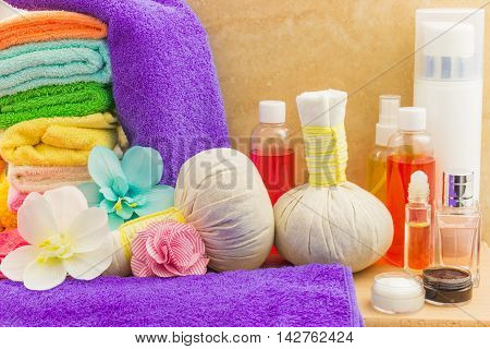 Composition with spa healthcare products: towels pouches flowers orchid bottles cream