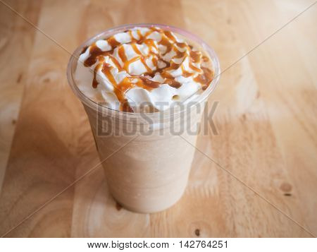 Coffee caramel frappe with whipped cream in a coffee shop