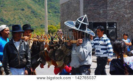 Cuicocha, Imbabura / Ecuador - June 22 2014: Indigenous group celebrating the solstice party near Cuicocha lagoon