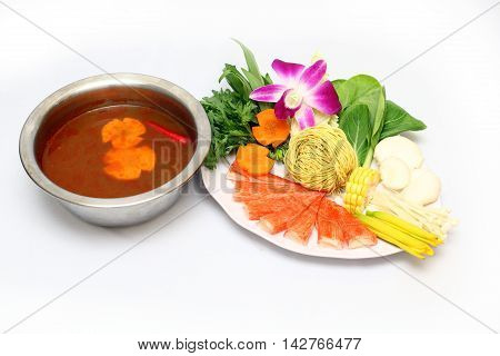Vietnamese spicy hot pot with mushroom corn cabbage crab tempura carrot and dried noodle on white background