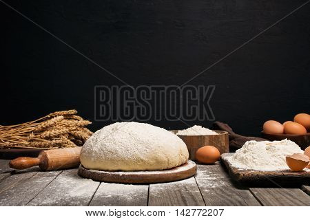 Fresh yeast dough for baking pizza or bread on wooden table