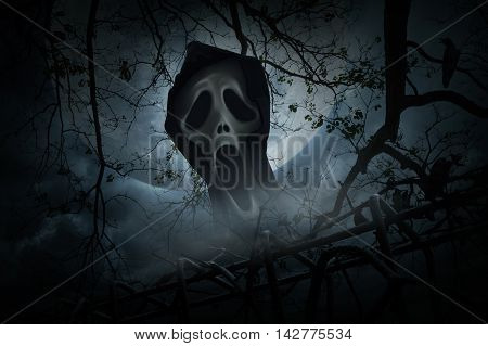 Ghost scream with old fence over smoke dead tree crow moon and cloudy sky Spooky background Halloween concept