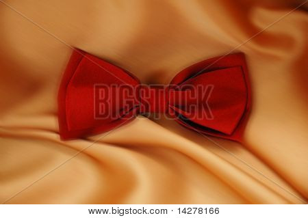 Red bow tie on orange background