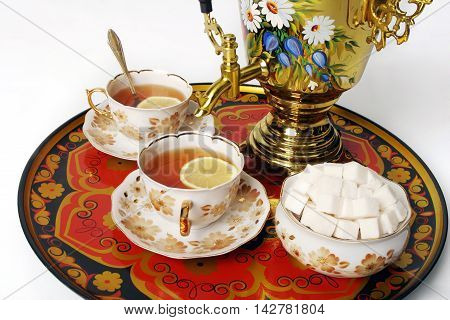 Samovar standing on a table with two cups of tea