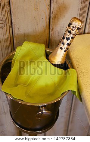 champagne bottle cool down in bucket close up photo