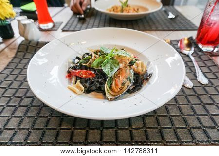 spicy seafood ink squid spaghetti on the table