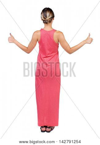 Back view of  woman thumbs up. Rear view people collection. backside view of person. Isolated over white background. A slender woman in a long red dress showing a thumbs up with both hands.