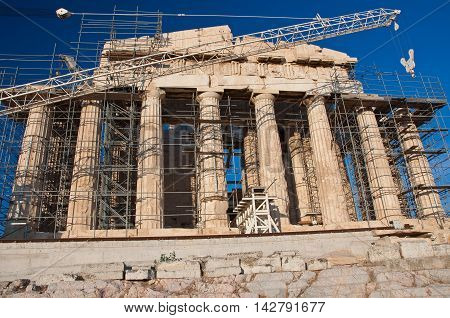 The Parthenon under reconstruction on the Athenian Acropolis Greece.