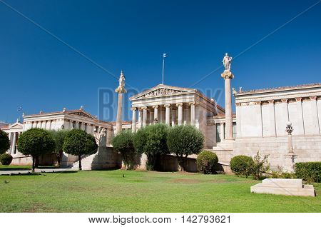 View of the Academy of Athens with Plato and Socrates monument in Athens Greece.