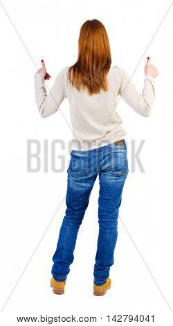 Back view of  woman thumbs up. Rear view people collection. backside view of person. Isolated over white background. The girl in a white warm sweater raised both hands thumbs up
