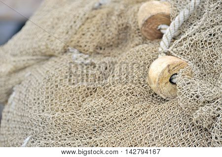fishing net with floats in boat, close up