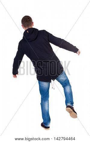 Balancing young man.  or dodge the falling man. Rear view people collection.  backside view of person.  Isolated over white background. Man in warm jacket falls while standing on the left leg.