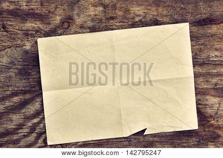 Grunge vintage old paper blank letter over obsolete wooden background.