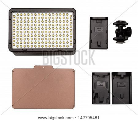On-camera LED video light kit flat lay. Video Light tungsten filter mounting thread adapters for battery. On white background.