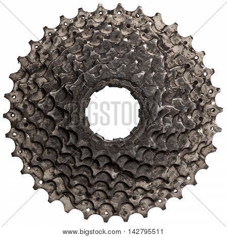 The used bicycle rear cassette with worn teeth isolated