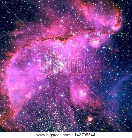NGC 346 is an open cluster with associated nebula located in the Small Magellanic Cloud that appears in the constellation Tucana. Retouched colored image. Elements of this image furnished by NASA.