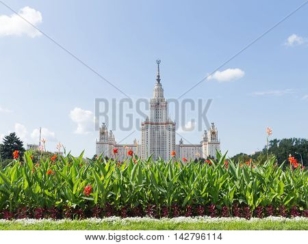 Moscow - August 11 2016: Moscow State University named after Lomonosov on the Sparrow Hills and beautiful red flowers in the foreground August 11 2016 Moscow Russia