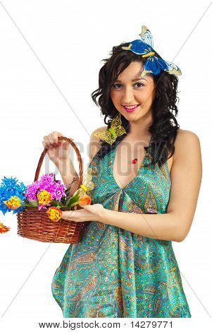 Spring Girl Showing Basket With Flowers
