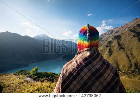 Tourist Woman In Rainbow Hat At The Mountains