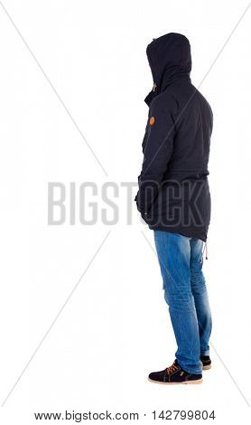 Back view of handsome man in winter jacket  looking up.   Standing young guy in parka. Rear view people collection.  backside view of person.  Isolated over white background. The guy in the stands
