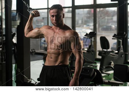 Young Man Doing Heavy Weight Exercise For Biceps