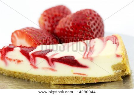 A Cheesecake Slice Garnished With Strawberries