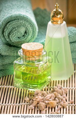Spa setting oil shampoo sea salt and towel spa concept