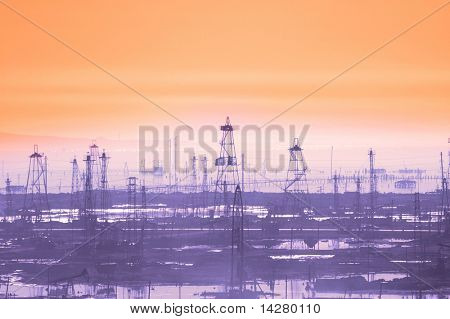 Oil derricks on early  morning - Caspian see near Baku