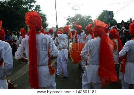 AMRAVATI, MS, INDIA - SEPTEMBER 11: Ganesha idols are being transported for immersion with drums in water bodies on September 11, 2014 in Amravati, Maharashtra, India. This is an annual festival.