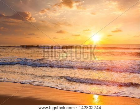 Sunrise with rising sun on morning beach. With lens flare and light leak