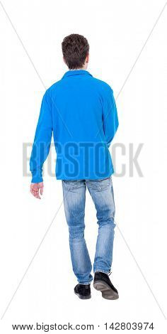 Back view of going  handsome man. walking young guy . Rear view people collection.  backside view of person.  Isolated over white background. Curly boy in a warm blue sweater walking waving his arms.
