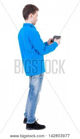back view of business man uses mobile phone.    rear view people collection. Isolated over white background. backside view of person. Curly boy in blue jacket plays games on the tablet.