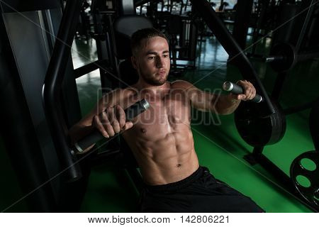Chest Exercise On Machine In A Gym